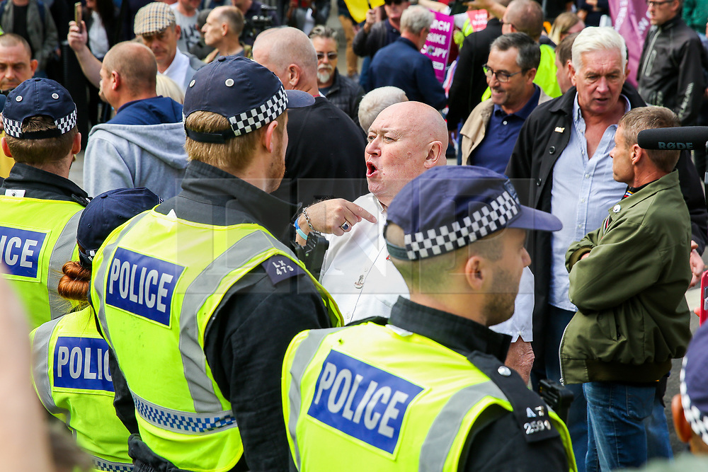 """© Licensed to London News Pictures. 07/09/2019. London, UK. Pro Brexit protesters confront police officers in Whitehall as anti-Brexit protesters take part in """"Defend our Democracy and Stop Brexit"""" demonstration in Whitehall, Westminster. The protesters are demonstrating against the British Prime Minister Boris Johnson's intention to prorogue Parliament until 14 October. Photo credit: Dinendra Haria/LNP"""