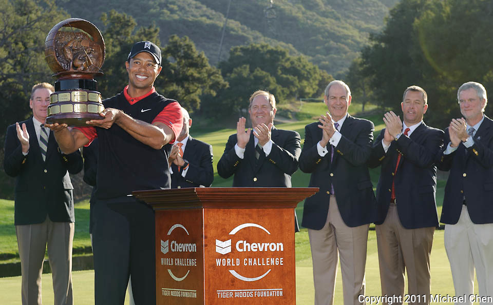 Tiger Woods hoists the championship trophy following his victory at the 2011 Chevron World Challenge at the Sherwood Country Club in Thousand Oaks, Calif., on Sunday, Dec. 4, 2011.  Woods snapped a two-year victory drought, edging Zach Johnson by one stroke.