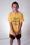 An individual child wearing a yellow t-shirt, with a neutral expression.