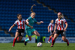CHESTERFIELD, ENGLAND - Sunday, April 25, 2021: Liverpool's Amy Rodgers (C) is sandwiched by Sheffield United's Rhema Lord-Mears (L) and Maddy Cusack during the FA Women's Championship game between Sheffield United FC Women and Liverpool FC Women at the Technique Stadium. Liverpool won 1-0. (Pic by David Rawcliffe/Propaganda)