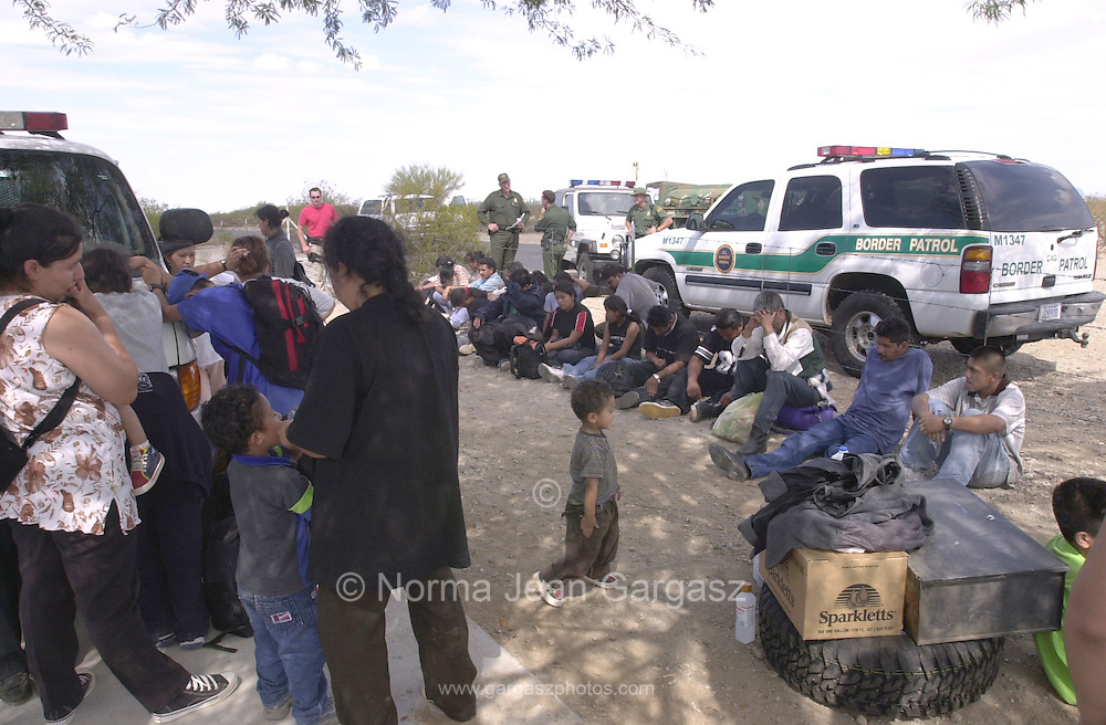 A group of 76 illegal immigrants from Mexico wait to be processed by Border Patrol agents in Sells after the three vehicles they occupied tried to outrun agents on Route 19 on the Tohono O'odham Reservation.  Four other vehicles in the caravan of seven managed to elude agents.  (PHOTO: NORMA JEAN GARGASZ)