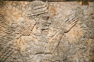 Assyrian relief sculpture panel  of a female protective spirit  from Nimrud, Iraq.  865-860 B.C North West Palace, Room I.  British Museum Assyrian  Archaeological exhibit  ref WA 124581 .<br /> <br /> If you prefer to buy from our ALAMY PHOTO LIBRARY  Collection visit : https://www.alamy.com/portfolio/paul-williams-funkystock/ancient-assyria-antiquities.html  Refine search by adding background colour, place, subject, museum etc into the LOWER SEARCH WITHIN GALLERY box to <br /> <br /> Visit our ANCIENT ASSYRIAN PHOTO COLLECTIONS for more photos to download or buy as wall art prints https://funkystock.photoshelter.com/gallery-collection/Ancient-Assyrian-Art-Artefacts-Antiquities-Historic-Sites-Pictures-Images-of/C0000cjRqQyJjLag