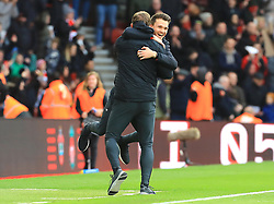 Southampton head of goalkeeping Dave Watson (left) and first team assistant manager Danny Rohl celebrate after the final whistle