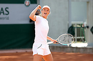 Iga Swiatek of Poland celebrates winning a point against Rafael Nadal of Spain - they practice together 20 minutes - ahead of the French Open 2021, a Grand Slam tennis tournament at Roland-Garros stadium on May 29, 2021 in Paris, France - Photo Jean Catuffe / ProSportsImages / DPPI