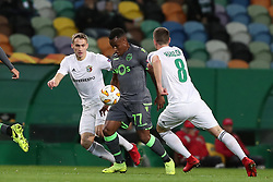 December 13, 2018 - Lisbon, Portugal - Sporting's forward Jovane Cabral from Cabo Verde vies with Vorskla's defender Igor Perduta (L) and midfielder Artem Habelok during the UEFA Europa League Group E football match Sporting CP vs FC Vorskla Poltava at Alvalade stadium in Lisbon, Portugal on December 13, 2018  (Credit Image: © Pedro Fiuza/NurPhoto via ZUMA Press)