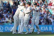 Steven Smith of Australia is congratulated after taking the wicket of Captain Alastair Cook of England during the 3rd day of the Investec Ashes Test match between England and Australia at the Oval, London, United Kingdom on 22 August 2015. Photo by Phil Duncan.