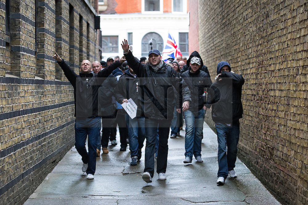 """© Licensed to London News Pictures . 04/01/2014 . London , UK . A demonstration by far right groups including the English Defence League , English Volunteer Force, New British Union and English Nationalist Alliance against a planned anti-gambling demonstration by """" The Sharia Project """" heading towards Regents Park Mosque in London today (4th January 2014) . The Sharia Project opposes democracy and wish for a global caliphate governed by Sharia law . Photo credit : Joel Goodman/LNP"""