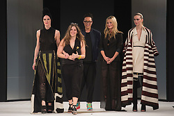 © Licensed to London News Pictures. 02/06/2015. London, UK. Melissa Villevieille from Edinburgh School of Art (pictured with Gok Wan and Laura Whitmore) winner of the Womenswear Award and the Catwalk Textiles Award. Graduate Fashion Week 2015 concludes with the Gala Awards Show at the Old Truman Brewery, London. Photo credit : Bettina Strenske/LNP