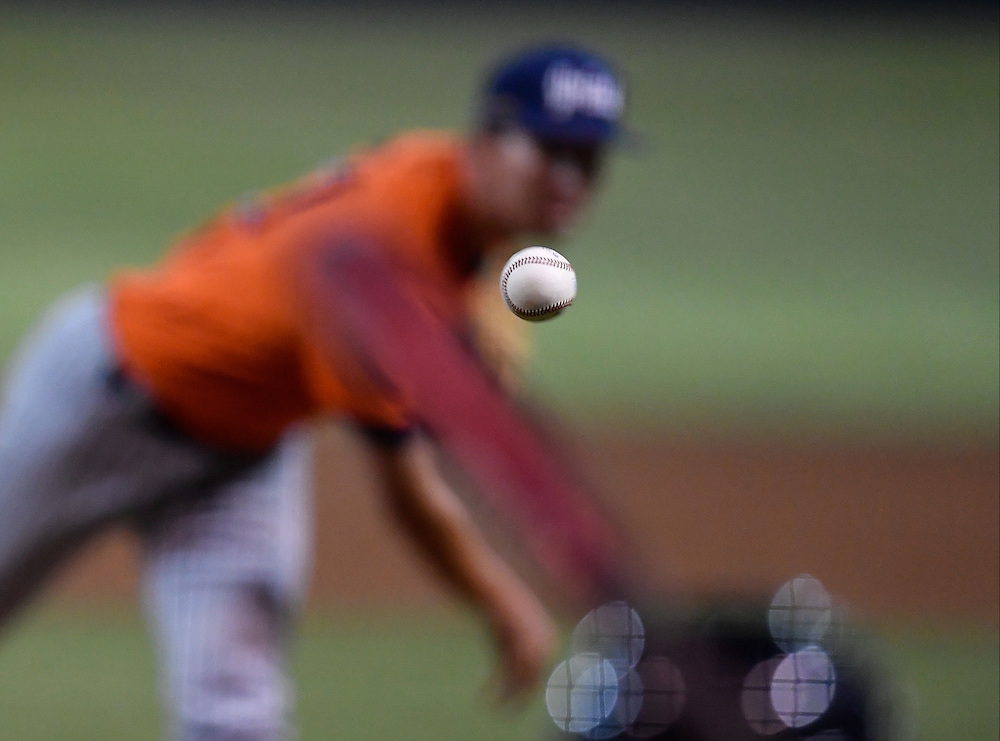 Cal State Fullerton Pitcher delivers late in the game against Cypress College on Friday evening.