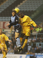 Picture: Henry Browne.<br />Date: 22/11/2003.<br />Coventry City v Gillingham Nationwide Division One.<br /><br />Stephen Warnock of Coventry and Gillingham's Nyron Nosworthy go for the ball