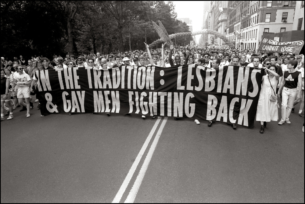 """ACT UP NY, on June 24, 1989, the 20th anniversary of the Stonewall riots, participating in a renegade march up 6th avenue to Central Park. Themed, """"In The Tradition"""", this march followed the same route as the original march 20 years ago and was designed as a rebuke to the corporatization of the gay pride parade."""