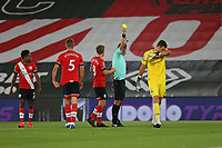 Football - 2020 / 2021 EFL Cup - Round 2 -Southampton vs. Brentford <br /> <br /> Referee Mr John Brooks shows a yellow card to Southampton's Alex McCarthy during the EFL cup tie at St Mary's Stadium Southampton<br /> <br /> COLORSPORT/SHAUN BOGGUST