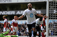 Tottenham Hotspur's Younes Kaboul celebrates after he scores his sides 3rd goal to make it 3-1 .Barclays premier league match ,Tottenham Hotspur v Fulham at White Hart Lane in Tottenham, London  on Saturday 19th April 2014.<br /> pic by John Patrick Fletcher, Andrew Orchard sports photography.