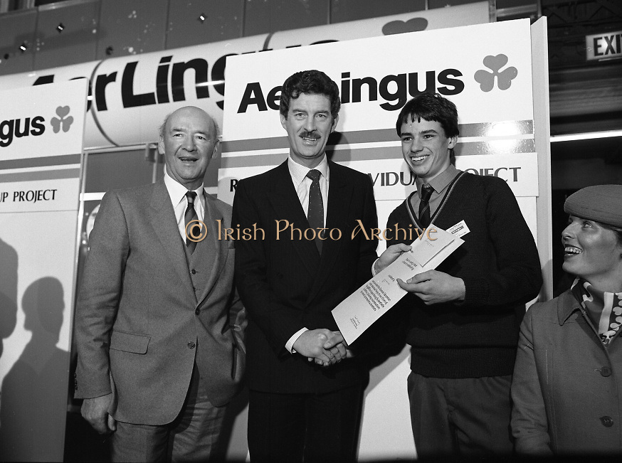 """Aer Lingus Young Scientist Exhibition..1986..10.01.1986..01.10.1986..10th January 1986..The annual Aer Lingus,sponsored,Young Scientists Exhibition was held at the RDS,Ballsbridge,Dublin.The Overall winners of the competition were Ms Breda Maguire and Ms Niamh Mulvany..They are students at The Rosary College,Raheny,Dublin. The Tanaiste, Mr Dick Spring TD was on hand to present the awards...Photograph of Shane Donovan,.Silverdale Road,Ballinlough,Cork being awarded the Runner-up Individual Award By Tanaiste Mr Dick Spring. Dr Michael Dargan,Chairman,Aer Lingus is also pictured..Shane submitted a project called """"The quality of water in the aquifiers of the Cork regionwith reference to industrial development"""". Thisis Shane's third entry into the competition. Last year Shane won the """"Chemistry Association Of Ireland Award""""..This year as part of his prize,Shane, will be invited to attend the European Space Agency Base on the occasion of the space craft """"Giotto"""" meeting """"Halleys Comet""""."""