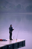 Fishing from dock on a foggy morning at the Lafayette Reservoir, Lafayette, Contra Costa County, California
