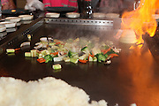 USA, New York City Asian restaurant, Stir fried vegetables are prepared in front of the guests