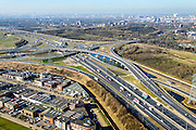 Nederland, Zuid-Holland, Rotterdam, 18-02-2015; Vaanplein. Kruising A 29 met A15 (diagonaal en vlnr). A15 is verbreed. Skyline Rotterdam aan de horizon.<br /> Traffic junction Vaanplein after construction of new overpass in connection with the road widening of motorway A15. <br /> luchtfoto (toeslag op standard tarieven);<br /> aerial photo (additional fee required);<br /> copyright foto/photo Siebe Swart