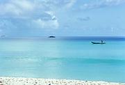 One canoe in calm blue ocean scene in Seychelles, Indian Ocean, 1980