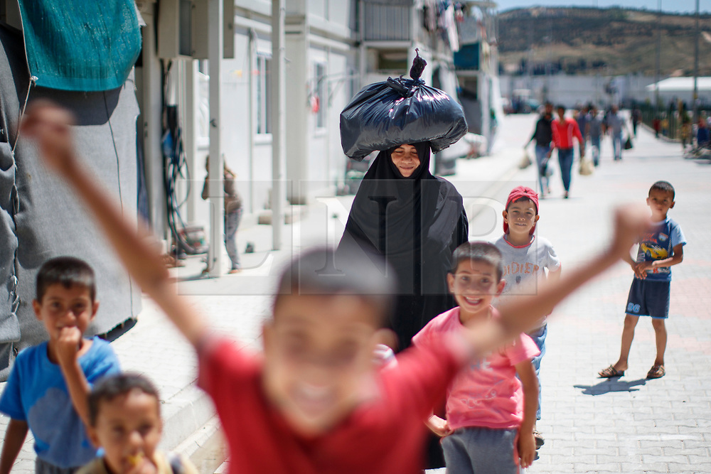 © Licensed to London News Pictures. 28/05/2017. Antakya, TURKEY. Syrian children play at Altınözü refugee camp on the Turkish-Syrian border in Antakya, Turkey on the first day of Ramadan during Former Minister of State for Faith and Communities, Baroness Warsi's visit. Photo credit: Tolga Akmen/LNP