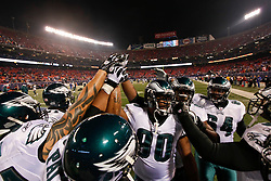 Philadelphia Eagles Linebackers come in for a huddle before the NFL game between the Philadelphia Eagles and the New York Giants on December 13th 2009. The Eagles won 45-38 at Giants Stadium in East Rutherford, New Jersey. (Photo By Brian Garfinkel)
