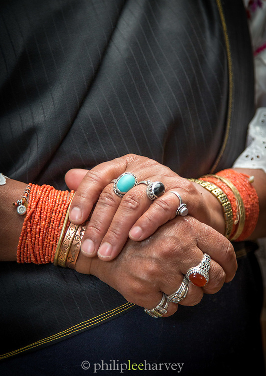 Detail of a ladies hands wearing traditional jewelry. Otavalo, Ecuador