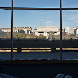 A panoramic view of the museums and buildings along the mall from the inside of the Hirshhorn Museum of the Smithsonian Institution.