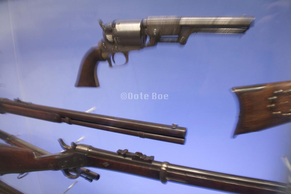 various old guns displayed