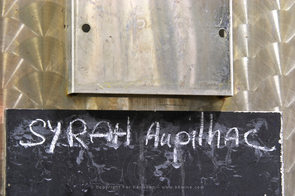 Syrah. Domaine d'Aupilhac. Montpeyroux. Languedoc. Sign on tank. Stainless steel fermentation and storage tanks. Floating top vats. France. Europe.