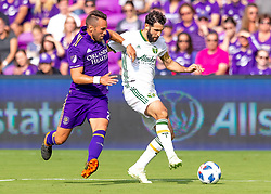 April 8, 2018 - Orlando, FL, U.S. - ORLANDO, FL - APRIL 08: Orlando City midfielder Scott Sutter (21) trys to get the ball from Portland Timbers midfielder Diego Valeri (8) during the MLS soccer match between the Orlando City FC and the Portland Timbers at Orlando City SC on April 8, 2018 at Orlando City Stadium in Orlando, FL. (Photo by Andrew Bershaw/Icon Sportswire) (Credit Image: © Andrew Bershaw/Icon SMI via ZUMA Press)