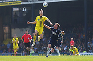 Burton Albion midfielder Alex Bradley (15) and Southend United defender Taylor Moore (23) during the EFL Sky Bet League 1 match between Southend United and Burton Albion at Roots Hall, Southend, England on 22 April 2019.