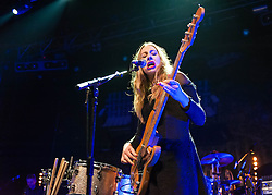 © Licensed to London News Pictures. 09/12/2013. London, UK.   Haim performing live at The Forum. In this picture - Este Haim.  Haim is an American indie rock band consists of sisters Este Haim (bass/vocals), Danielle Haim (guitar/vocals) and Alana Haim (guitar/vocals/keyboards) with drummer Dash Huttong<br /> <br /> Haim were nominated in the Brand New for 2013 category in the 2013 MTV Music Awards, and won the Sound of 2013 category in the BBC Sound of 2013 awards. <br /> <br /> Photo credit : Richard Isaac/LNP