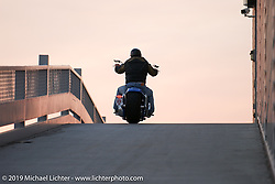 Arlen rides up the ramp to the second story of his new store. Dublin, CA. 2004. Photography ©2004 Michael Lichter.