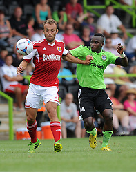 Liam Kelly of Bristol City and Forest Green Rovers Alhassan Bangura - Photo mandatory by-line: Dan Rowley/JMP  - Tel: Mobile:07966 386802 20/07/2013 -Forest Green Rovers  vs Bristol City  - SPORT - FOOTBALL - Forest Green Rovers - Bristol city  -