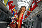 5/7/06 -- lake forest, IL, U.S.A<br />Eunice Buhler , one of USA TODAY's 2006 All-USA High School Academic Team members from Lake Forest High School, stands in the hall of flags in the International departures concourse at O'Hare International Airport. <br /><br />Photo by John Zich, USA TODAY contract photographer