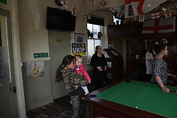 """© London News Pictures. """"Looking for Nigel"""". A body of work by photographer Mary Turner, studying UKIP leader Nigel Farage and his followers throughout the 2015 election campaign. PICTURE SHOWS - Members of the public watch while Nigel Farage visits the Wheatsheaf public house, where he toasted the birth of Princess Charlotte of Cambridge, in Ramsgate on May 2nd 2015. The Wheatsheaf was the last of the many pubs in Thanet that Nigel Farage visited on his long campaign. . Photo credit: Mary Turner/LNP **PLEASE CALL TO ARRANGE FEE** **More images available on request**"""