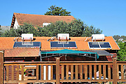 Israel, Upper Galilee, Solar water heaters on a roof