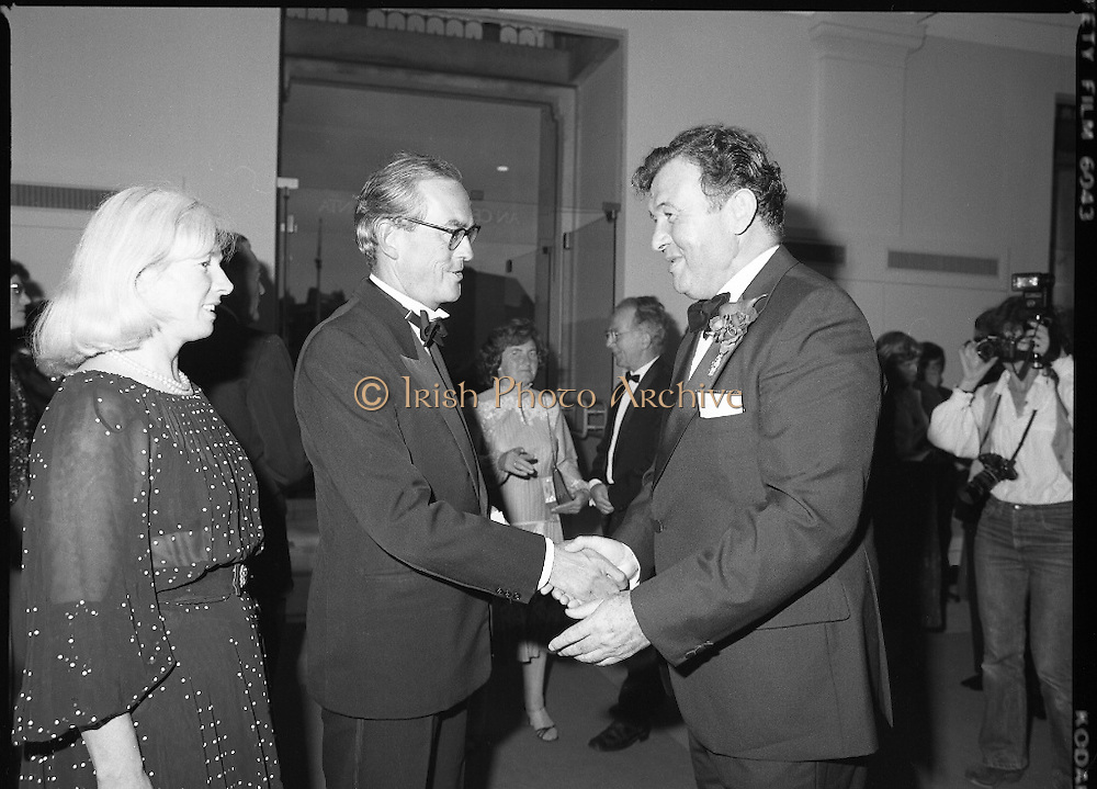State Opening Of The National Concert Hall. (N92)..1981..09.09.1981..9th September 1981..The President ,Dr Patrick Hillery, officially opened the new National Concert Hall,Earlsfort Terrace, Dublin. The state opening was followed by the premier concert performed by the Radio Telefís Eireann Symphony Orchestra with a large cast of soloists, choirs and the RTESO leader Audrey Park and conducted by RTE's Principal conductor Colman Pearce...Image shows Mr Fred O'Donovan,  Chairman, National Concert Hall Committee, greeting John and Delphine Kelly on their arrival at the National Concert Hall.