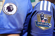 the New Premier League badge on the new Chelsea shirt and (r) the current Barclays Premier League Champions 2014/15 badge on the 2014/15 Chelsea shirt. Barclays Premier league match, Chelsea v Leicester city at Stamford Bridge in London on Sunday 15th May 2016.<br /> pic by John Patrick Fletcher, Andrew Orchard sports photography.