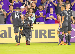 April 21, 2018 - Orlando, FL, U.S. - ORLANDO, FL - APRIL 21: Orlando City forward Dom Dwyer (14) celebrates his 100 MLS goal with his team mates during the MLS soccer match between the Orlando City FC and the San Jose Earthquakes at Orlando City SC on April 21, 2018 at Orlando City Stadium in Orlando, FL. (Photo by Andrew Bershaw/Icon Sportswire) (Credit Image: © Andrew Bershaw/Icon SMI via ZUMA Press)