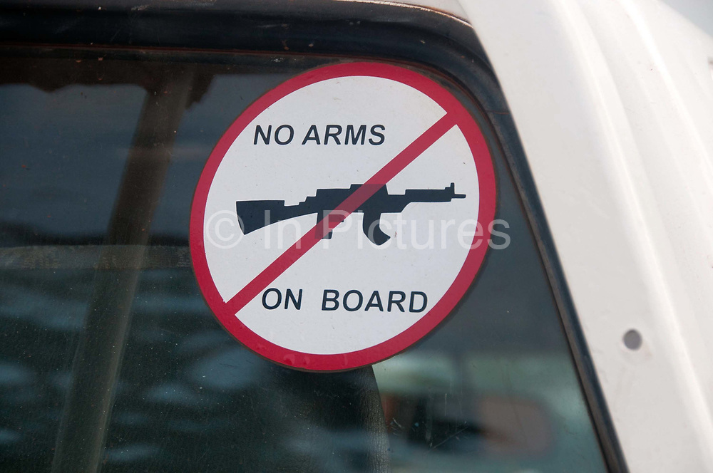 Central African Republic. August 2012. Batalimo. Sign on Merlin NGO vehicle saying 'No arms on board'.