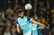 Derby County midfielder Graeme Shinnie (4) heads the ball during the EFL Sky Bet Championship match between West Bromwich Albion and Derby County at The Hawthorns, West Bromwich, England on 14 September 2021.