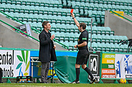 RED CARD Referee Alan Muir shows a red card to Motherwell FC manager Graham Alexander during the SPFL Premiership match between Hibernian FC and Motherwell FC at Easter Road, Edinburgh, Scotland on 27 February 2021.