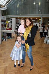 LILY HODGES and her children LOLA-SOFIA HODGES and JONATHAN HODGES at the Plusher Fair, Lindley Hall, Royal Horticultural Halls, Vincent Square, London, on 9th November 2013.