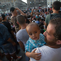 Illegal migrant father and child attends a protest against their denial to travel to Germany at the main railway station Keleti in Budapest, Hungary on September 02, 2015. ATTILA VOLGYI