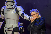 Carrie Fisher brings her dog and then flirts with a stormtrooper - The European Premiere of STAR WARS: THE FORCE AWAKENS - Odeon, Empire and Vue Cinemas, Leicester Square, London.