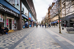 Glasgow, Scotland, UK. 23 March 2021. On the first anniversary of the coronavirus pandemic lockdown the streets in Glasgow city centre are still quiet with only essential shops open. Pic; Sauchiehall Street looks forlorn with few shops open or shoppers. Iain Masterton/Alamy Live News