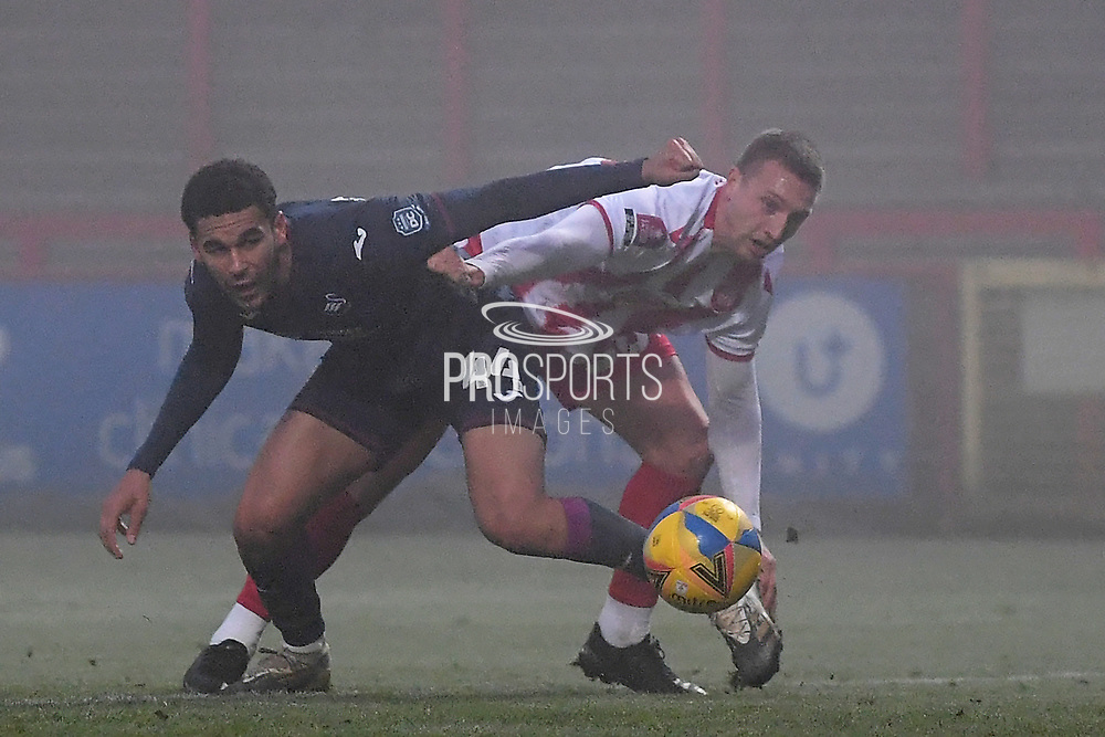 Swansea City defender Ben Cabango(44) and Stevenage forward Luke Norris(36) battles for possession during the FA Cup match between Stevenage and Swansea City at the Lamex Stadium, Stevenage, England on 9 January 2021.