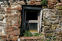 Old window and wall of abandoned croft house now used as animal barn, Durness, Scotland