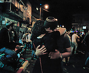 A young couple embraces near the Souk in Jerusalem on the night of Israeli Independence Day.