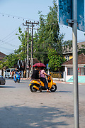 Morning traffic at the intersection of Kitsalat Road and Chaofa Ngum Road, Luang Prabang, Laos.